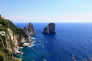 Gorgeous landscape of famous faraglioni rocks on Capri island, Italy.