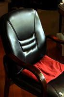 Black chair with red pillow