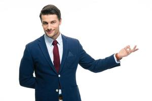 Businessman with arm out in a welcoming gesture