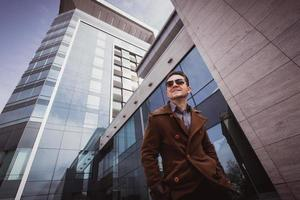 fashion man in front of a glass building photo