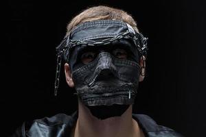 Image of madman in handmade mask