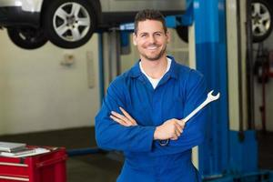 Mechanic smiling at the camera photo