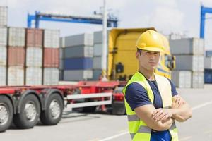 Portrait of confident mid adult man in shipping yard