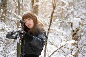 Girl aiming a gun photo