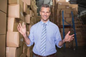 Portrait of smiling manager in warehouse photo