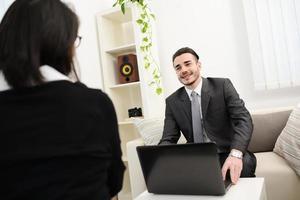 young  businessman agent salesman representative at customer home