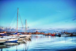 boats in Alghero harbor in hdr