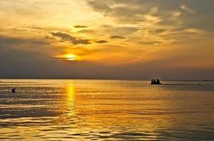 Barca al tramonto sul mare photo