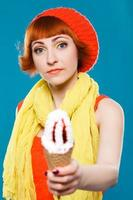 French woman wearing beret. blue background. Girl with ice cream