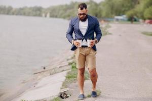 bearded man carrying coffee photo