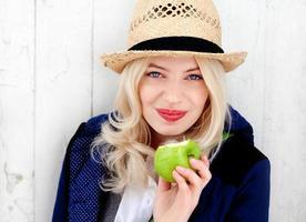 Funky healthy girl eating apple