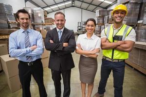 Warehouse team smiling at camera photo