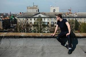 man posing in selvedge  jeans photo