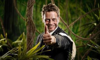 Winning adventurer businessman thumbs up photo