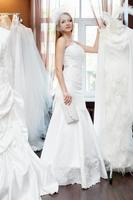 bride trying on dresses in the bridal salon