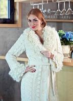 young beautiful woman in knitted coat photo