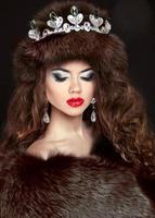 Beautiful brunette woman in mink fur coat. Jewelry. Fashion