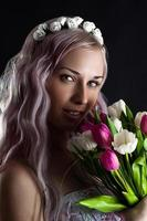 fashion woman face with a bouquet of tulips