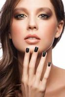 Woman with black manicure photo