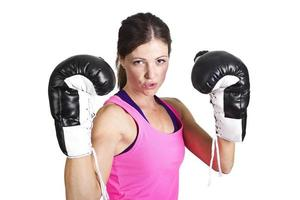 Fit woman wearing boxing gloves isolated