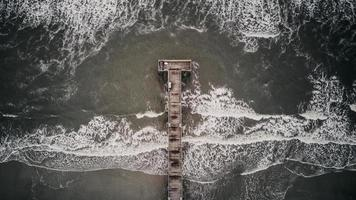 Aerial photo of a gray pier