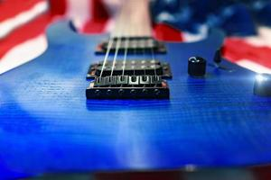 Close-up of a blue guitar with American flag