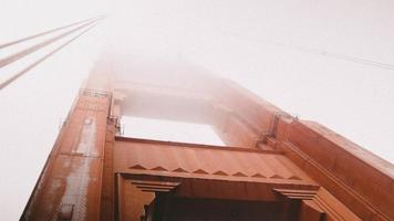 Looking up at fog and the golden gate bridge