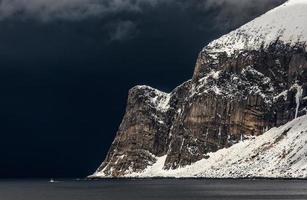 Coastal mountain covered by snow