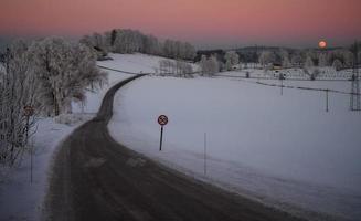 Gray asphalt road in winter