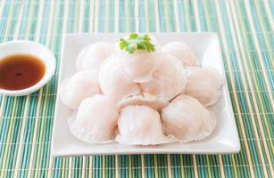 A plate of steamed dim sum dumplings