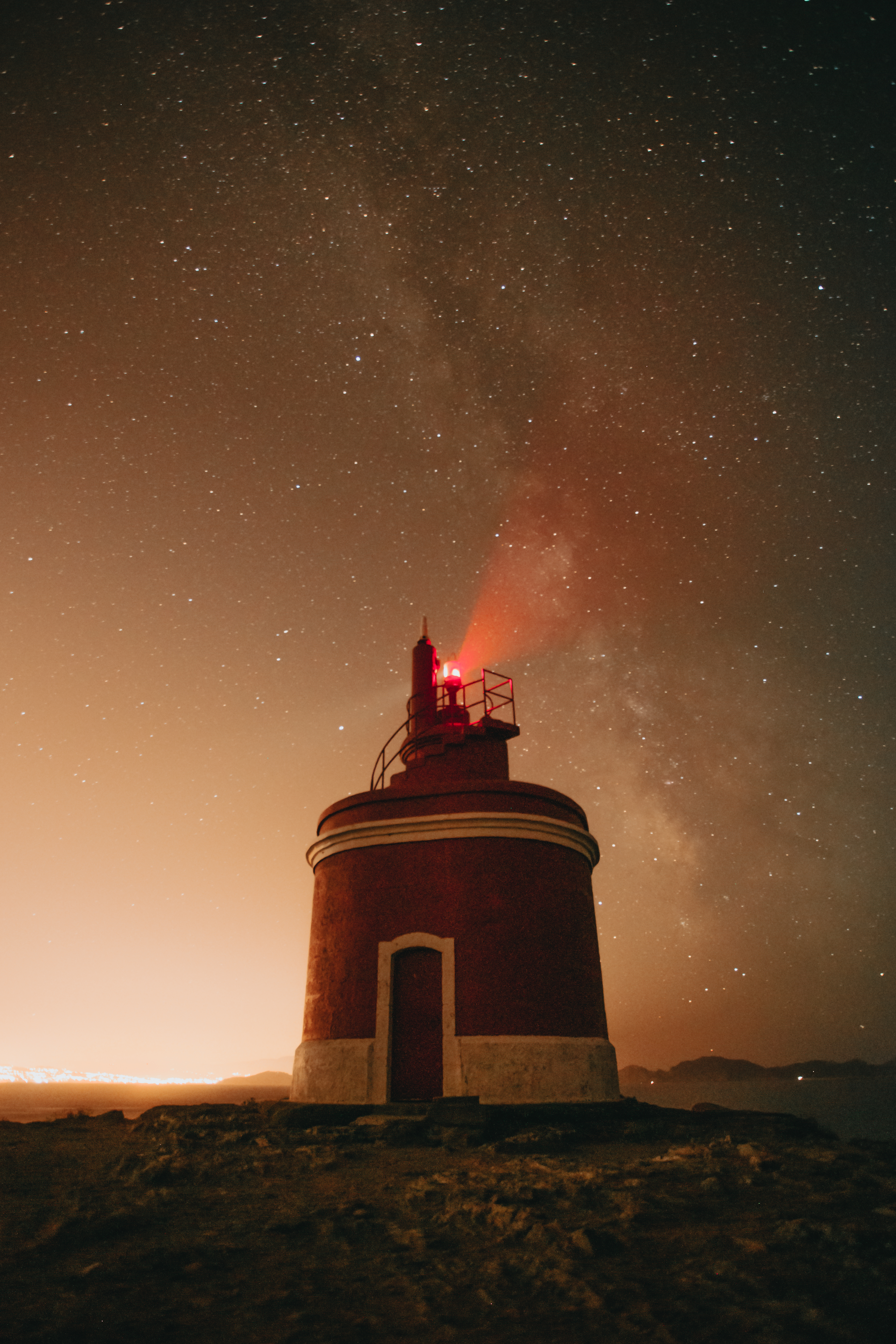 A horizontal shot of a lighthouse during the night