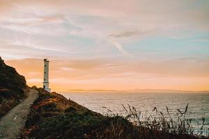 White lighthouse during the sunset