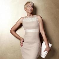 elegant blonde woman in fashionable dress.
