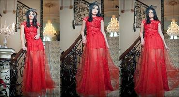 Sensual elegant young woman in red long dress indoor shot.