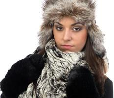 Portrait of young woman in fur cap photo