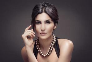 Fashion Portrait Of Beautiful Woman. Dark Background. photo