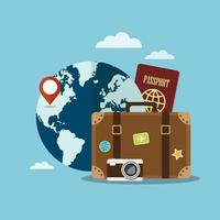 Suitcase and travel items in front of world vector