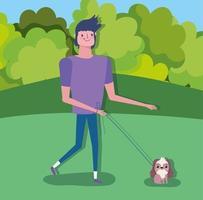 Happy man walking the dog outdoors
