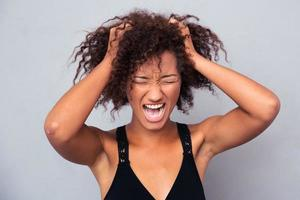 Portrait of afro american woman shouting photo