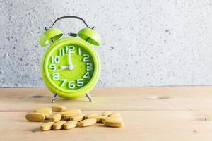 Medicine and clock  on wood background
