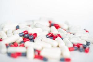 Closed up medicine capsule on white photo