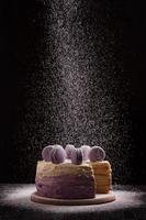 Delicious vegan cake with macaroons photo
