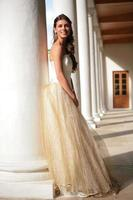 smiling princess in white-golden gown