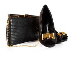 Black female leather bag and velvet shoes isolated