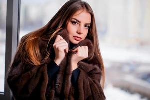 Fashion Winter beauty in fur coat over black photo