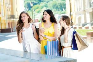 Godsend for shopaholics. Three attractive young girls holding bags