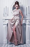 young beautiful woman in gorgeous silk dress photo