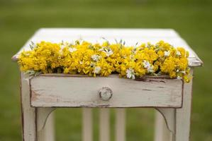 Old vintage table and flowers photo