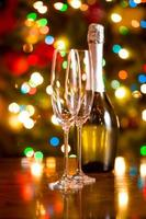 Christmas background with glasses and bottle of champagne photo