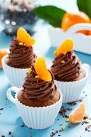 Chocolate cupcakes with orange and chocolate. photo